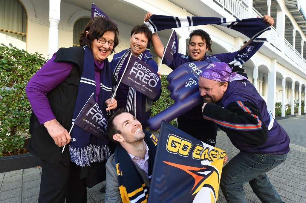 Eagles fan Leigh Dawson surrounded by Dockers supporters Jan Travia, Christine Byrne, Alex Merendino and Jon Gall. Picture: Jon Hewson        d443358
