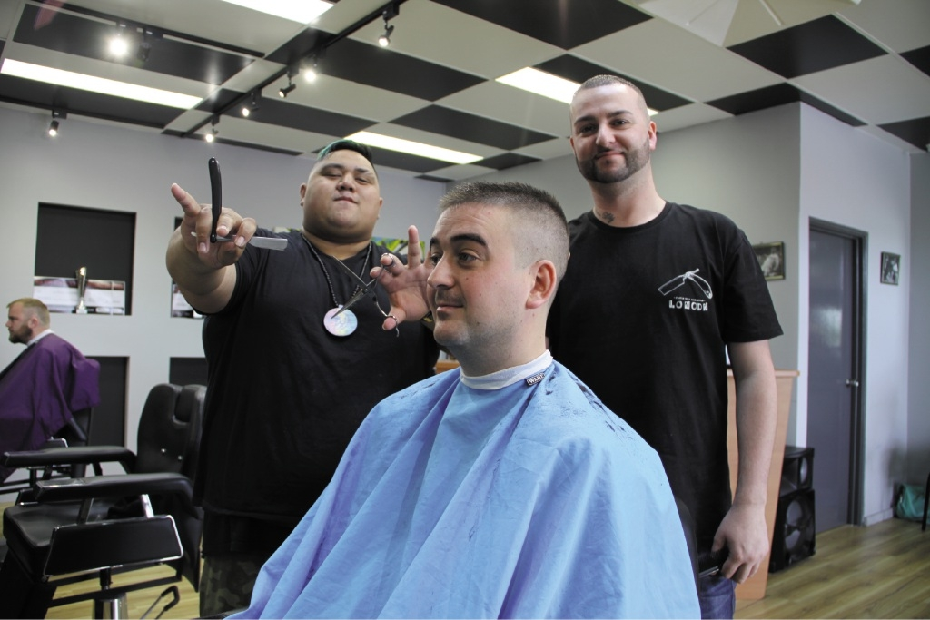Dan Clark getting styled by Hiawe Daly-Bercich (left) and Sonny Kirton.