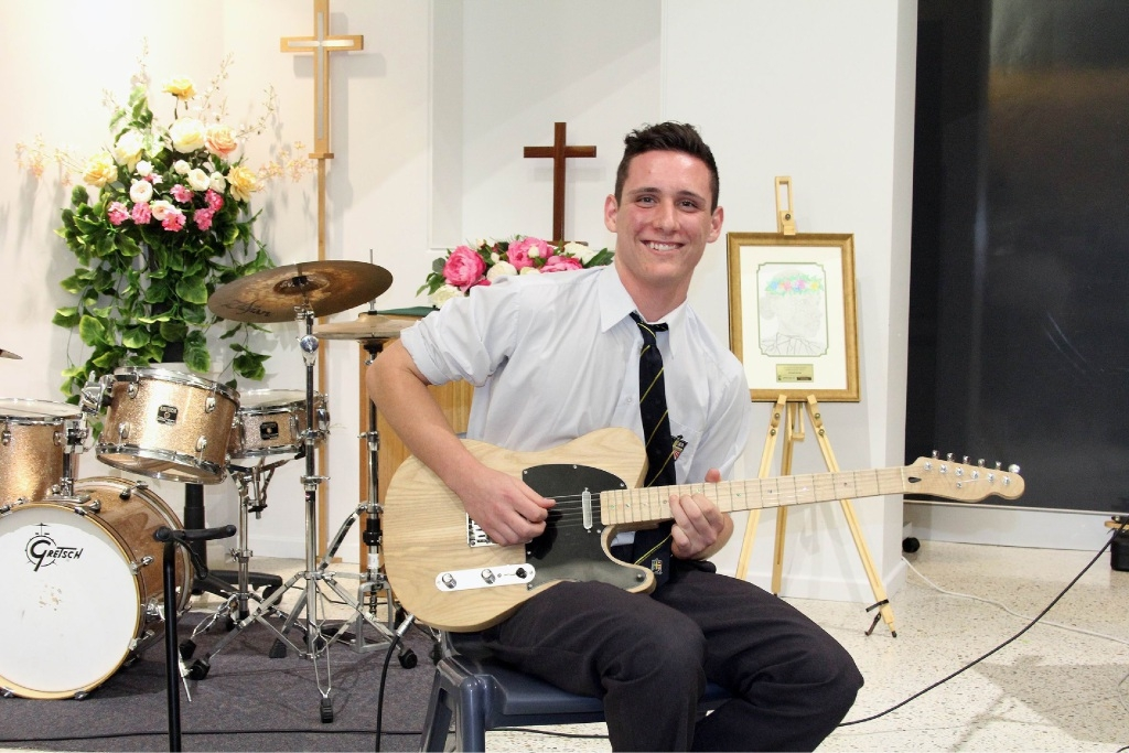 Year 12 student Connor Boyd plays a set on the guitar he made as part of his Year 12 studies.