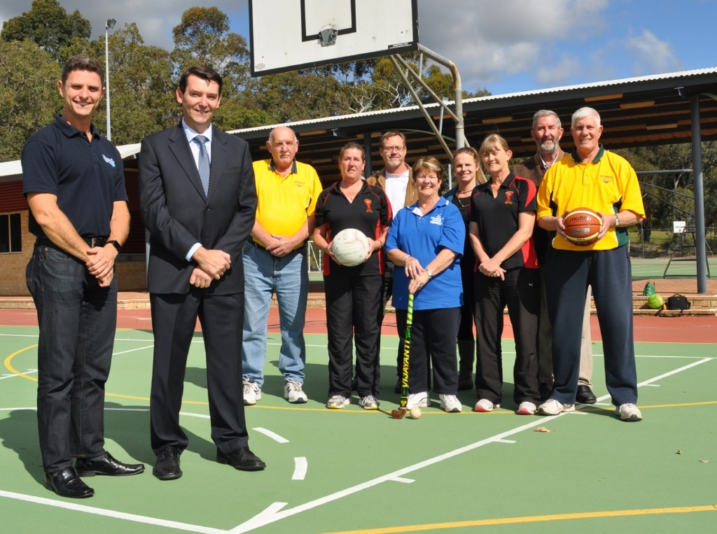 Shire of Mundaring recreation and leisure services manager Kirk Kitchin and Cr Darrell Jones with Mundaring Recreation Centre |Advisory Committee members.
