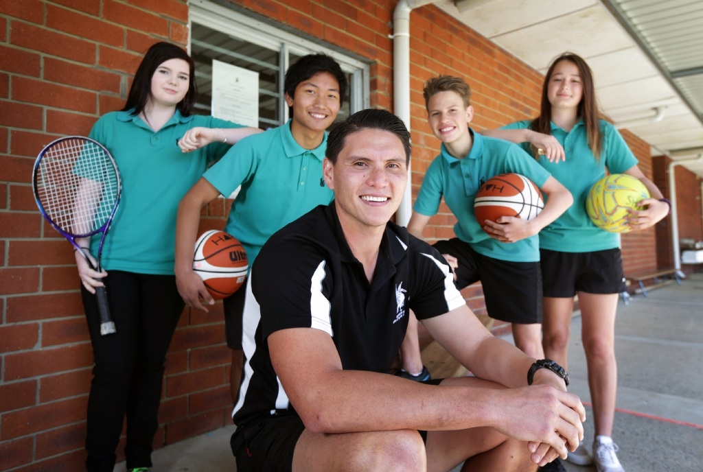 Teacher of the year nominee Sebastian Salinas flanked by students  Catherine DeGray, Jovic Lana, Caelan Toki and Emily Hodgson.Picture: David Baylis        www.communitypix.com.au   d444078