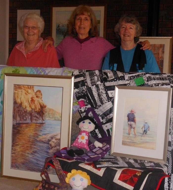 Janice Alexander, Pauline Gill and Melanie Lowden with a selection of their works.