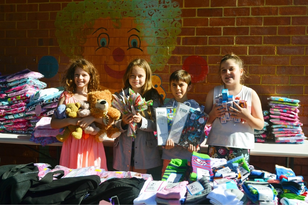 Chloe Desport, Siobhan Farquhar, Nicolas Stratos and Jami Brandhoff help put together Constable Care comfort packs.