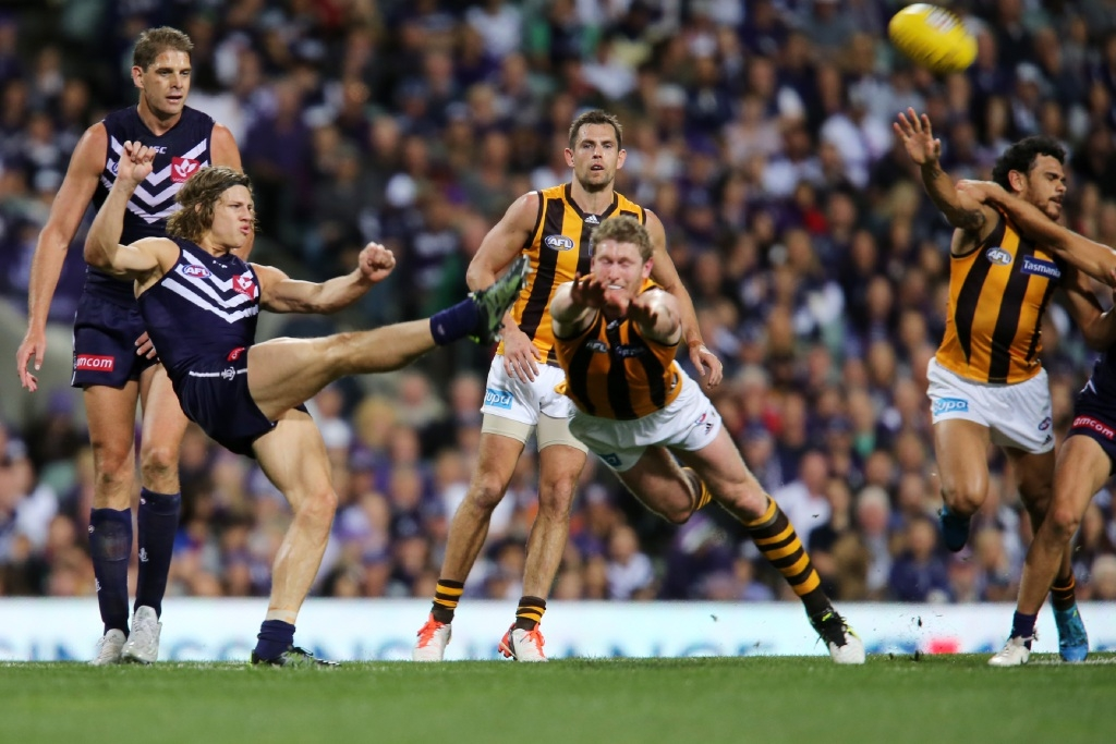 The Dockers were bundled out of the premiership race on Friday but West Coast booked its spot in the grand final with a win over North Melbourne.