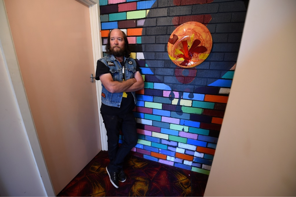 Artist Andrew Britton, who won the annual exhibition's major award last year, says he feels calmer when he is creating.  Picture: Jon Hewson www.communitypix.com.au   d444213