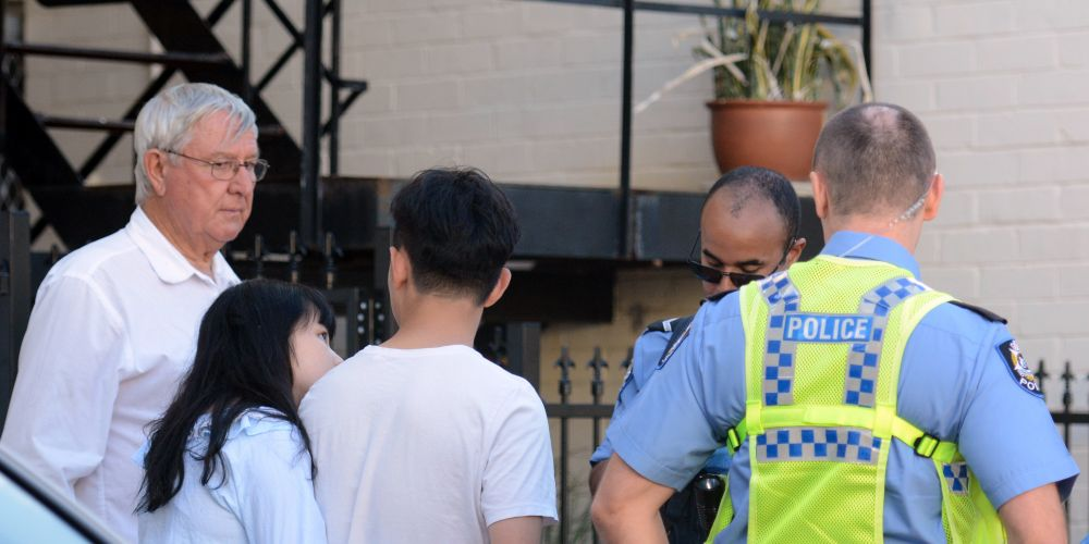 Mr Weygers (left) looks on as police talk to witnesses. Picture: Jon Bassett