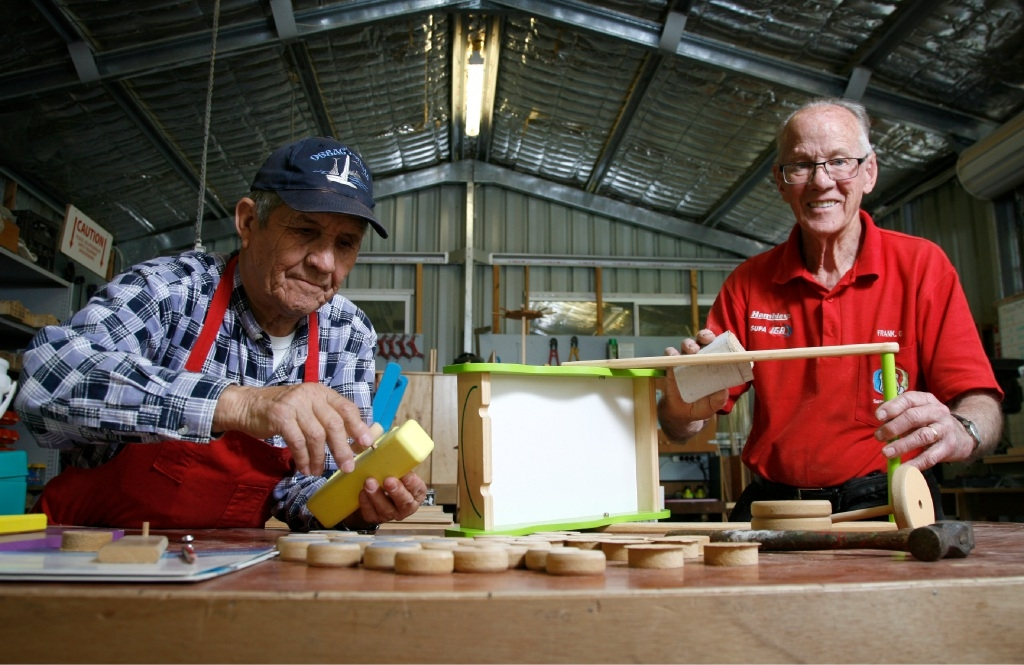 A Christmas story: Workshop Supervisor Jimmy Babaeff and toymaker and volunteer Frank Gordin are busy getting toys ready for under-privileged children this Christmas. Picture: Marie Nirme www.communitypix.com.au d443805