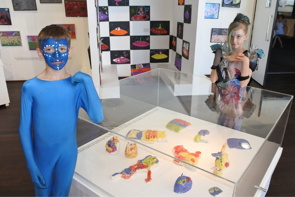 Students Nicholas Corica (10) and Milla Edwards (9) show off their creations in the People Beyond the Stars exhibition.