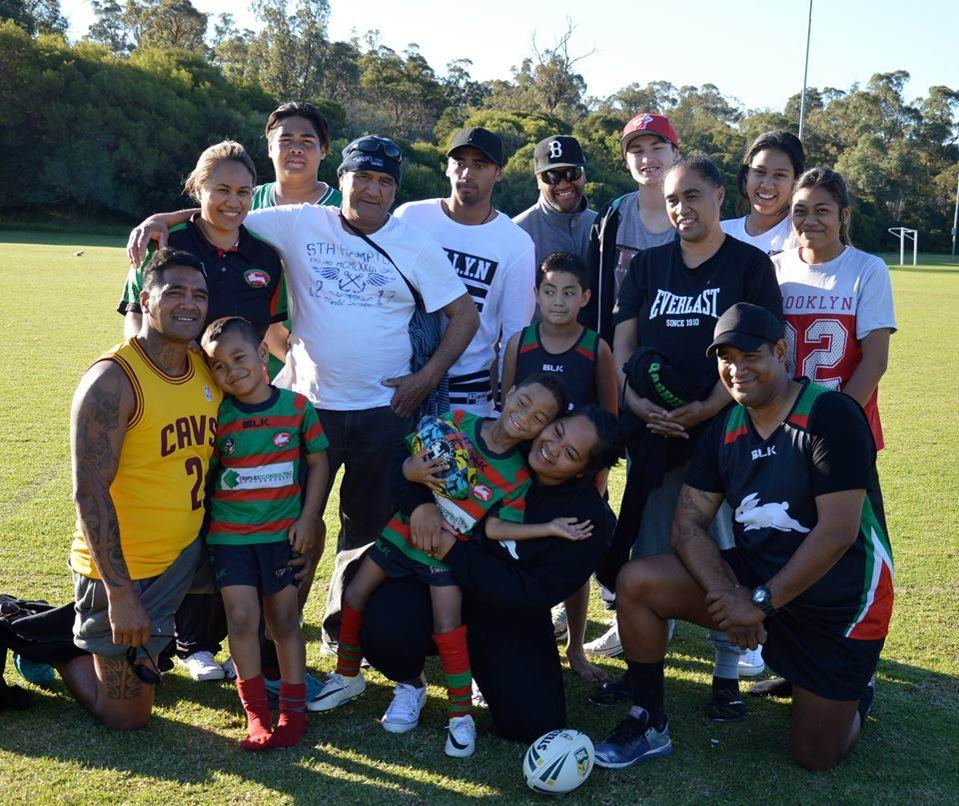 Four generations of Ellenbrook Rabbitohs supporters celebrate the club's win.