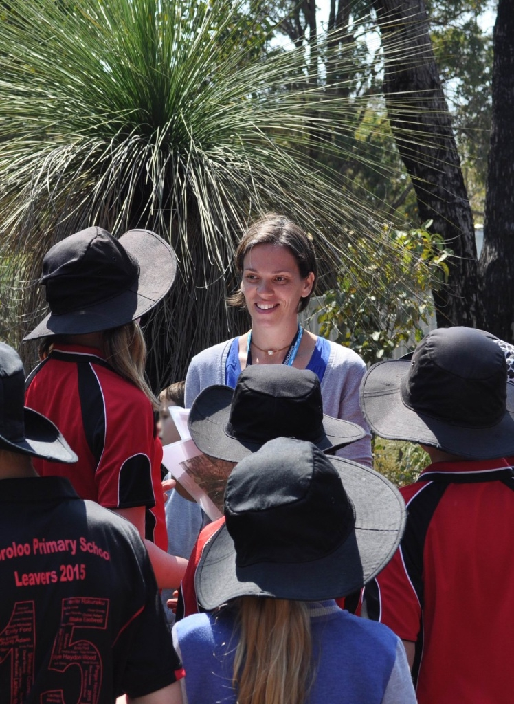 Shire environmental officer Justine Shailes with Wooroloo students.