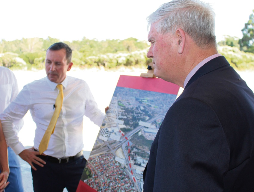Premier Mark McGowan visited Cockburn Central in January to pledge to scrap the Perth Freight Link and re-direct funding to the North Lake Road flyover. Mark McGowan with Cockburn Mayor Logan Howlett.