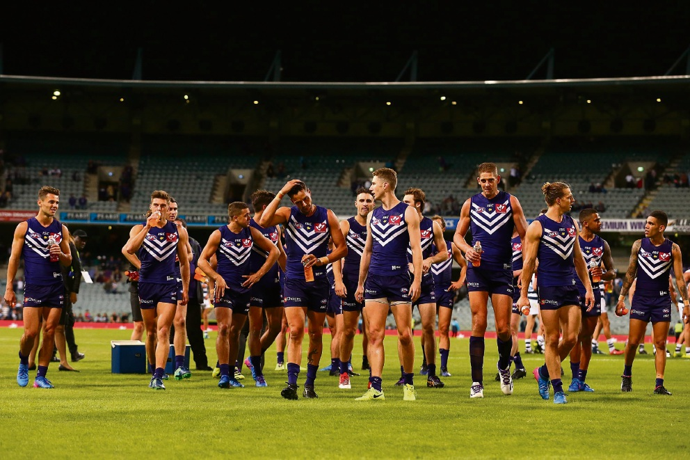 The Dockers walk from the field after being defeated by the Cats at Subiaco Oval on Sunday. Picture: Paul Kane/Getty Images