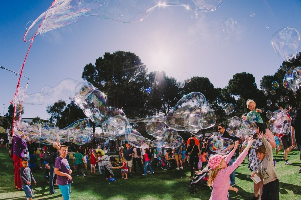 Children having fun with bubbles at last year's Little Feet Festival.