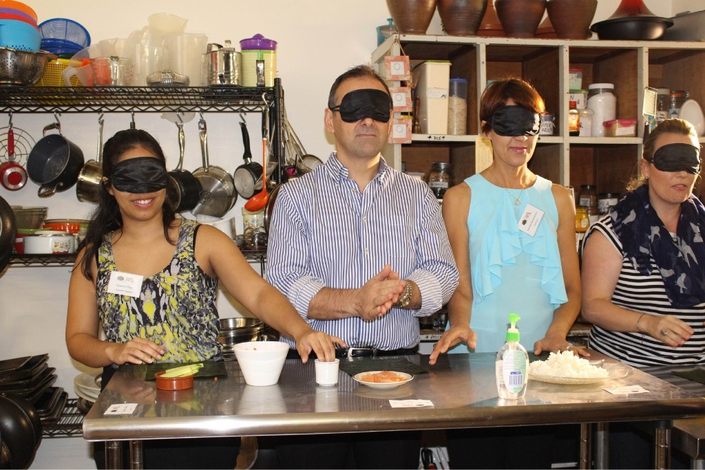 Southern Gazette reporter Susanne Reilly, North Metro MLC Peter Kastambanis, Karalee Kastambanis and Liz Sheehan try to make sushi while blindfolded.