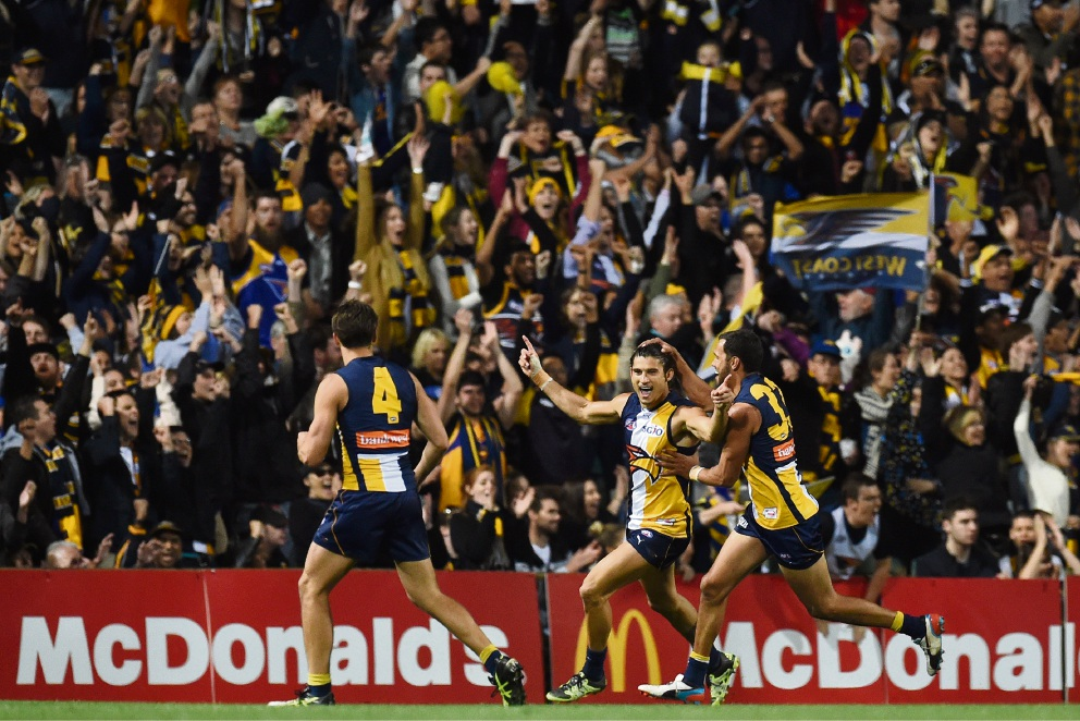 West Coast Eagles' Sharrod Wellingham celebrates with teammates Josh Hill and Dom Sheed during Saturday night's preliminary final victory over North Melbourne. Picture: Jon Hewson. d444347