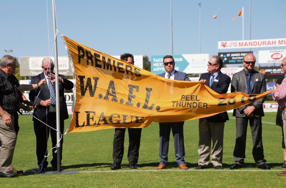 Top: The Peel Thunder 2016 premiership banner is unfurled on the weekend; Bottom from left: Gerald Ugle leads in a race to the footy; Bradley Walsh evades a tackle; Bradey Grey kicks a kick away. Pictures: Phil Elliott, Pixell Photography and Cofo Coto