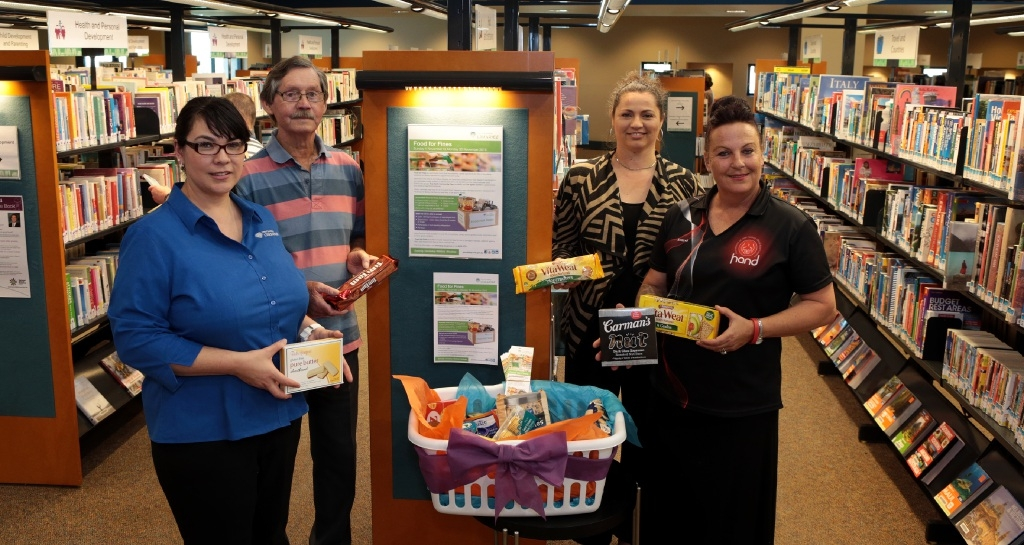 Library services officer Joanne Hall, Andrew Jones from The True North Church, Kyla Rasmussen from The Spiers Centre and Tanya Cairns from HAND.  Picture: Martin Kennealey        d444530