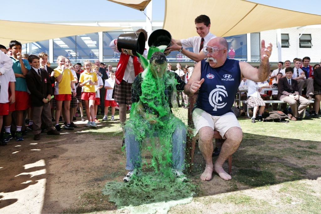 Deputy principals Lucio Cicchini and Trevor Lynch slimed by head girl Charlotte Groom and head boy Matt Melanko.Picture: Martin Kennealey         www.communitypix.com.au   d443854