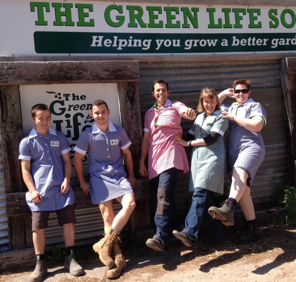 The Green Life Soil team members Luke Edgecumbe, Steve Buchanan, Paul and Linda Mitchener and Chaz Tingley in the uniforms they will wear for the fundraiser this weekend.