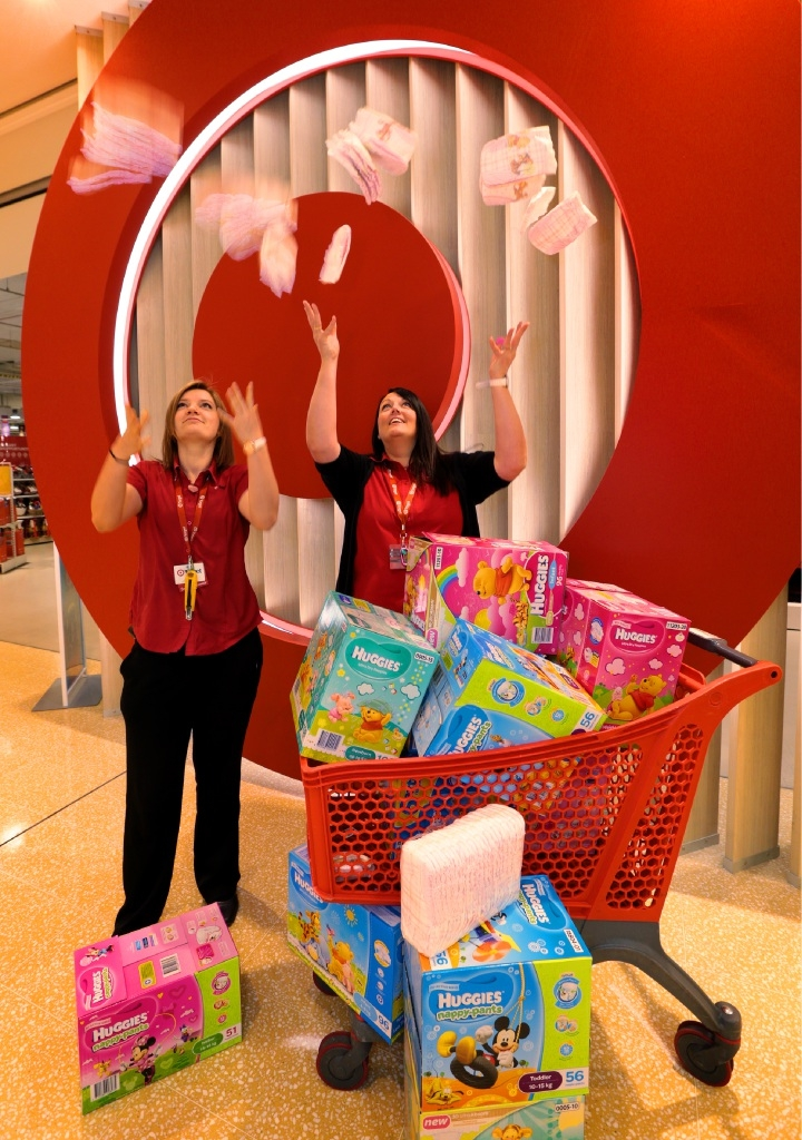Target staff Lauren and Nicky with donated nappies.       d444776