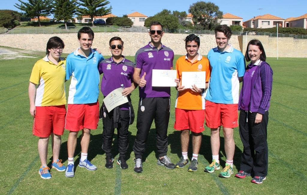 Students Connor Paragalli, Matthew Kolomyjec, Anthony Matteo and Harmon McAullay and teacher Danyella Roddis with Perth Glory players Hagi Gligor and Jerrad Tyson.
