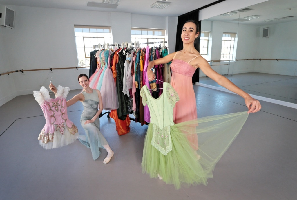 WA Ballet dancers Ashleigh Bennett and Polly Hilton with some of the costumes that will be offered for sale at the Grande Costume Sale on October 24.   Picture: David Baylis www.communitypix.com.au   d444393