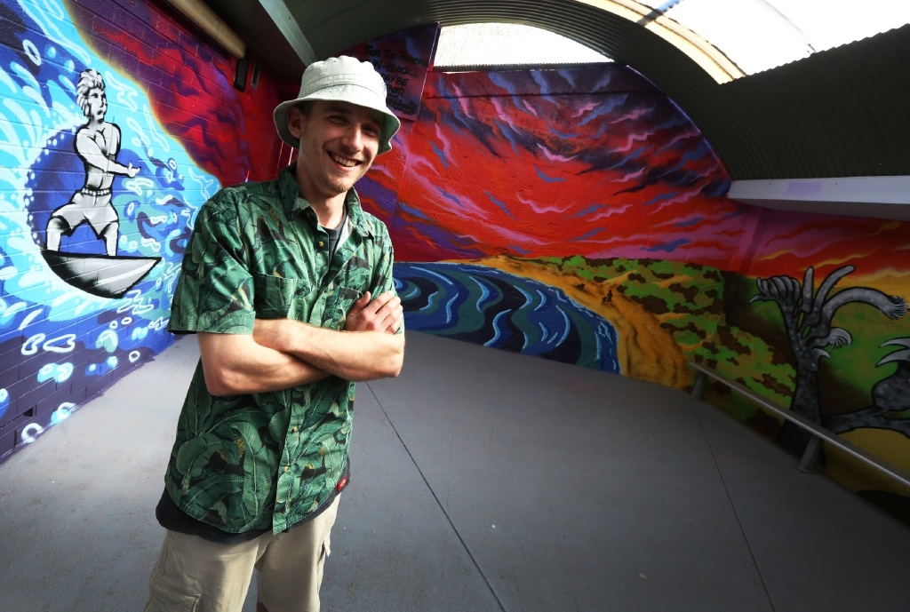 Artist Stephen Peacock with his mural at the mental health ward at Fremantle Hospital. Picture: Matt Jelonek           d444689