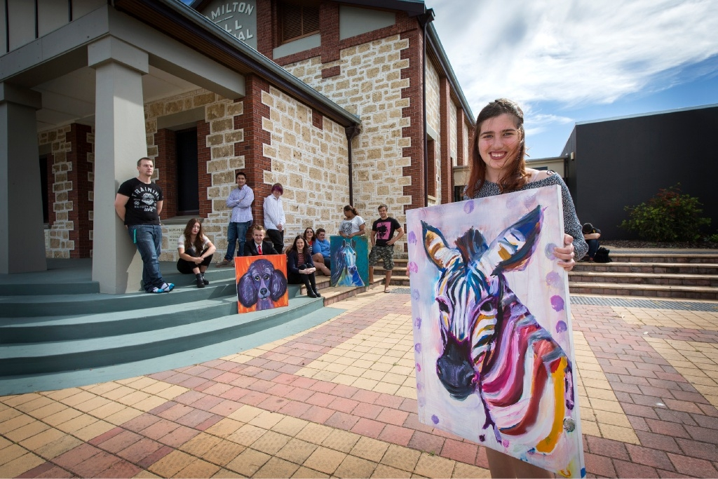 Erin Hayward with the painting Zazzy Zebra. Picture: Will Russell        www.communitypix.com.au   d444415