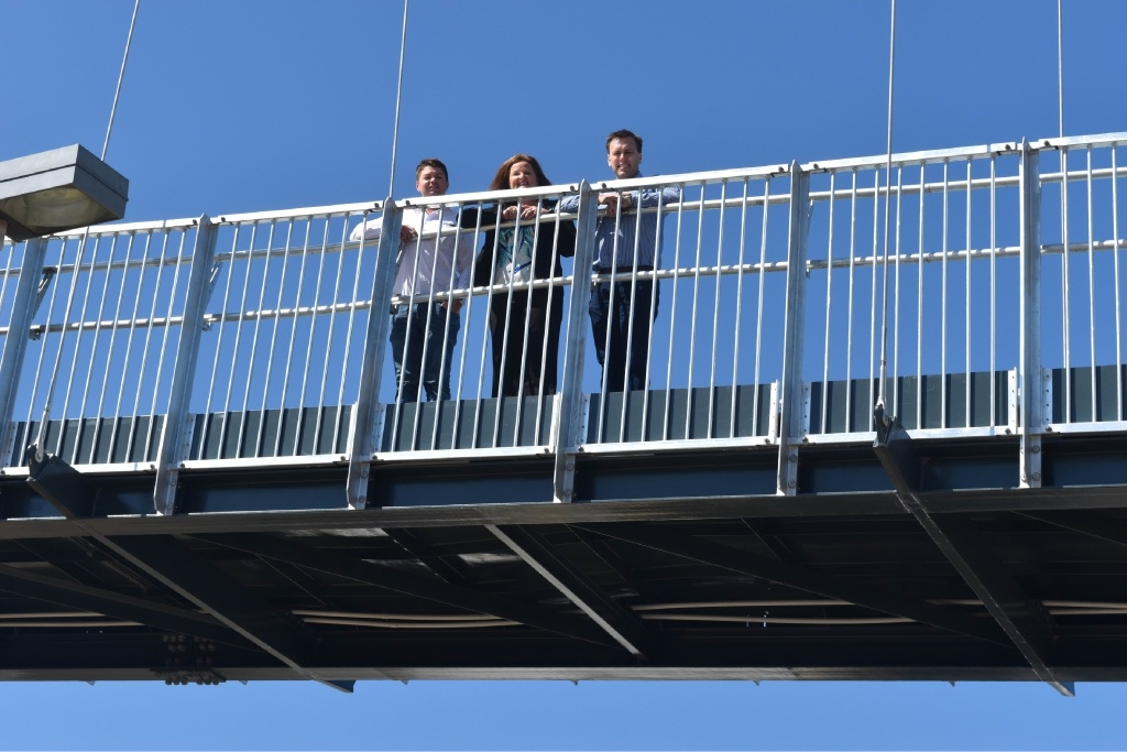Daniel Kennedy, Mandurah Mayor Marina Vergone and Tim Hartland gaze down at passing traffic.Greenfields children Brianna and Matthew were first on the bridge.