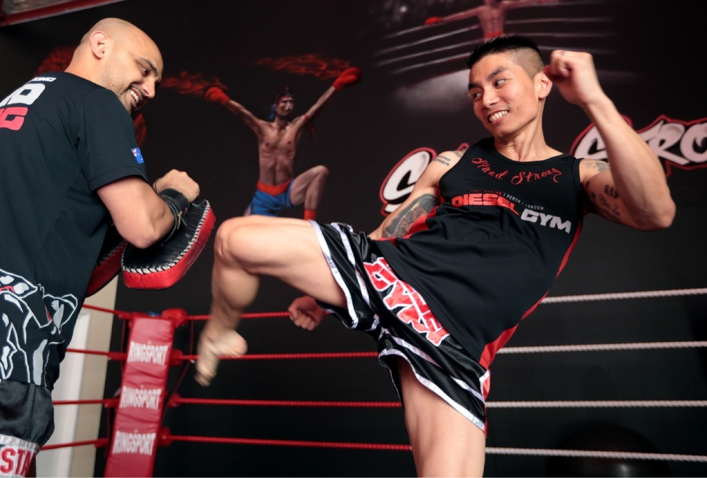 Jason Lee (right) and coach Frankie Dehghan in training.