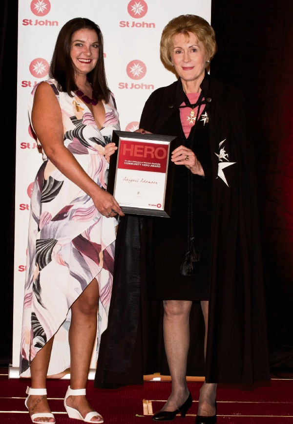 Abigail Adamson receives her award from WA Governor Kerry Sanderson.