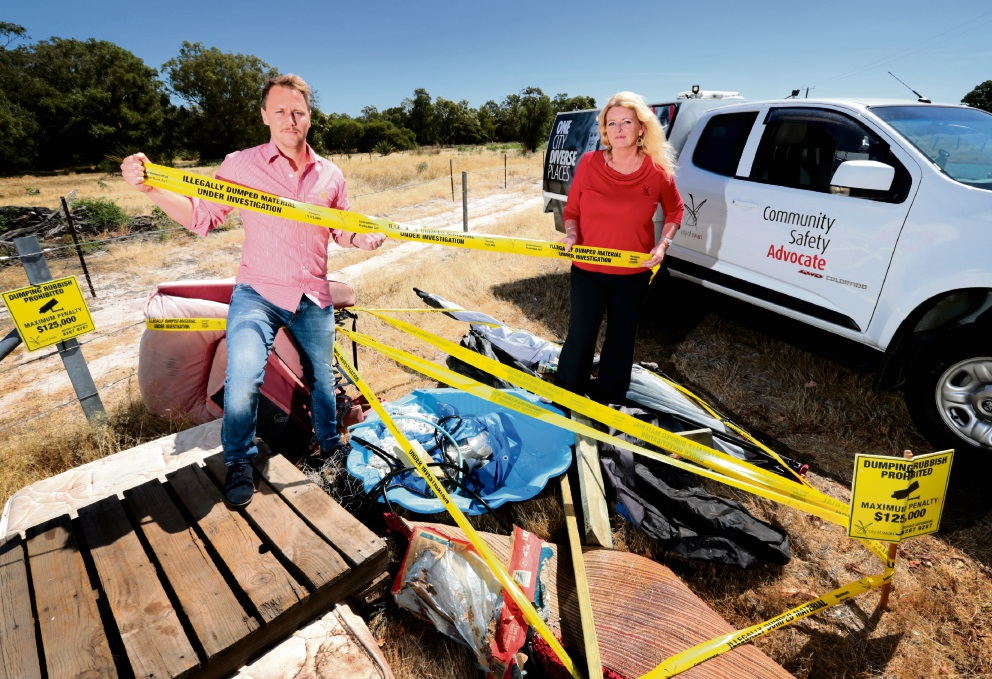 Cr David McDonnell and Carol James with some illegally dumped rubbish in Ellenbrook. Picture: David Baylis