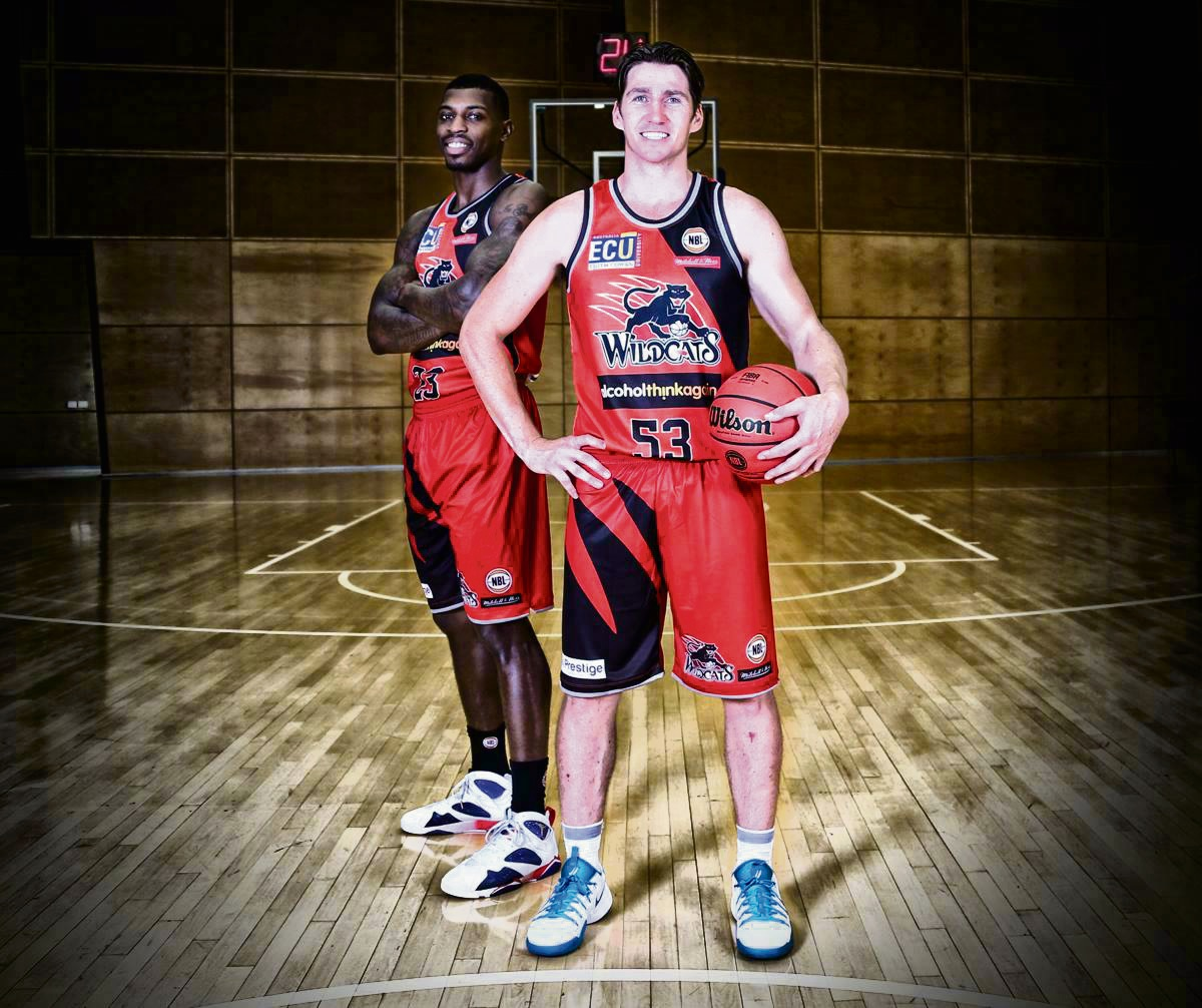 Casey Prather and captain Damian Martin model the 1995 championship lookalike uniform. Picture: Perth Wildcats Facebook