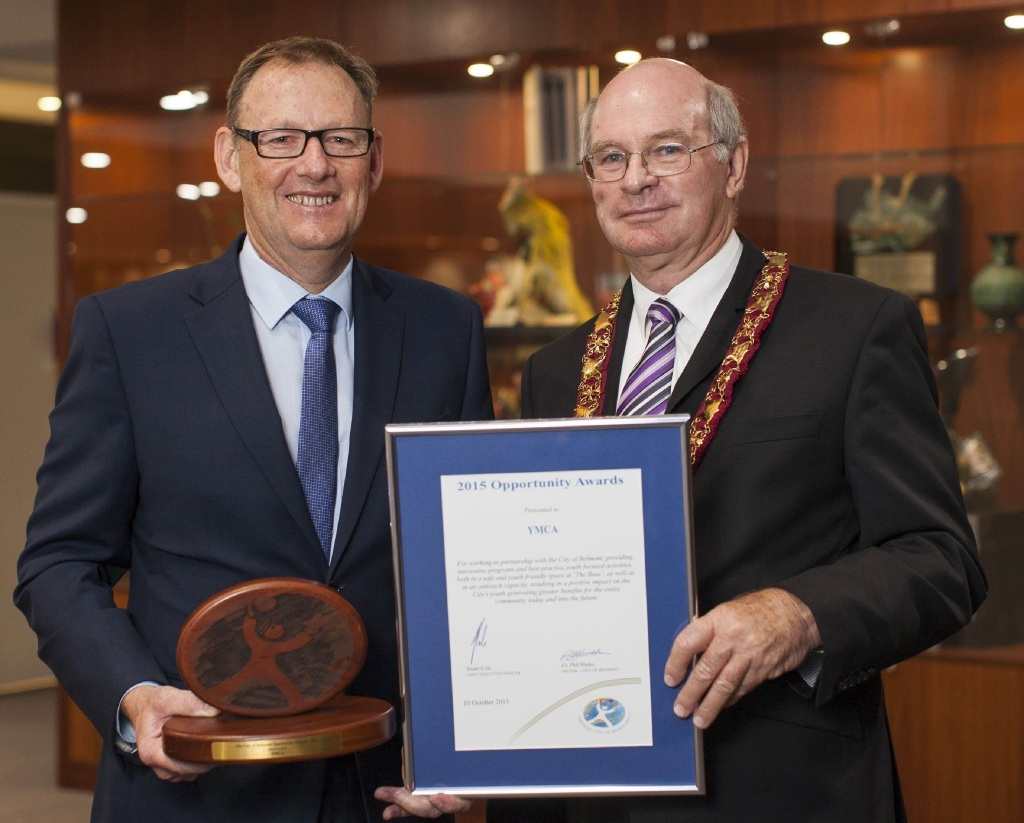 YMCA WA chief executive Ross Kyrwood receives the City of Belmont Opportunity Award from Belmont Mayor Phil Marks.