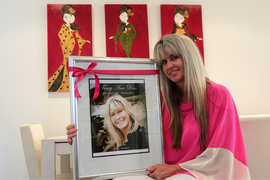 Ingrid Michell with a photo of friend Tracy Ross.  Picture: Martin Kennealey d445124