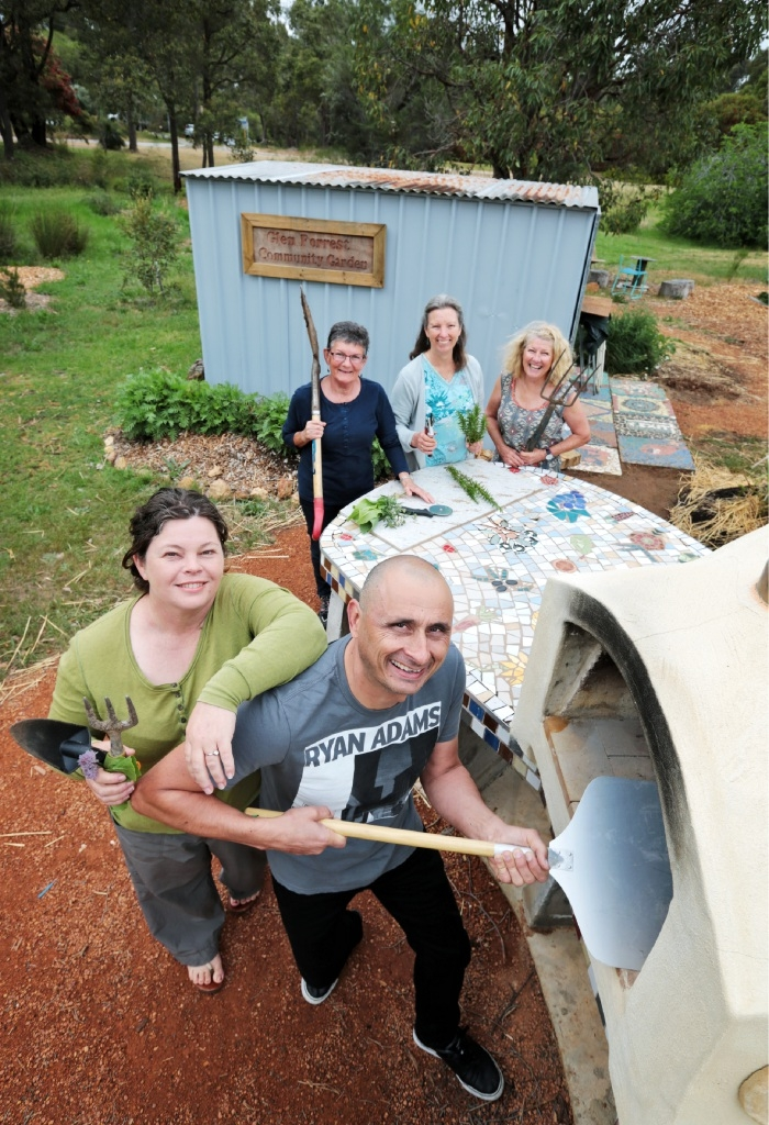 Sonia Smart, Jenny Currell and Linda Hatton (back) with Kerry Hawkins and Theo Kalogeracos (front) and the Glen Forrest Community Garden's new pizza oven. Picture: David Baylis www.communitypix.com.au   d445115
