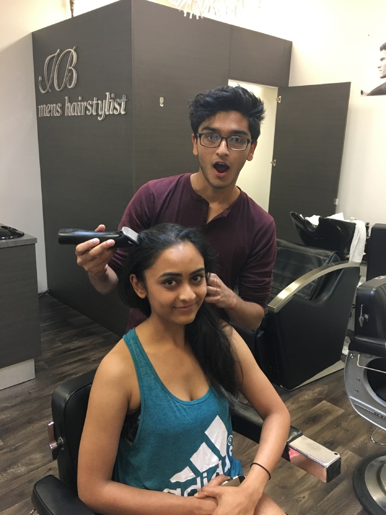 Prem (18) and Mansi Aghera (21) prepping for the Shave to Save.