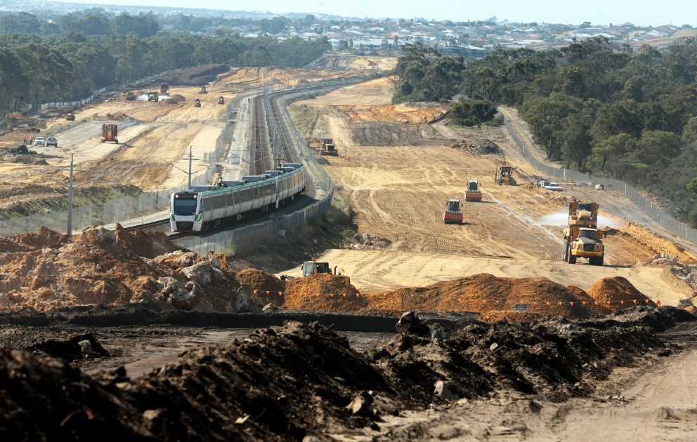 Weekender photographer Martin Kennealey, who was granted special access to tour the Mitchell Freeway extension project, took this picture of a train weaving through cleared bushland north of Burns Beach Road. Picture: Martin Kennealey        www.communitypix.com.au   d444264
