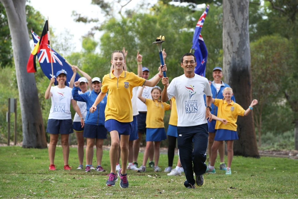 Year 5 student Sha Bloom with Bayarkhuu Batbar from The Peace Runners.Picture: Andrew Ritchie        d445444
