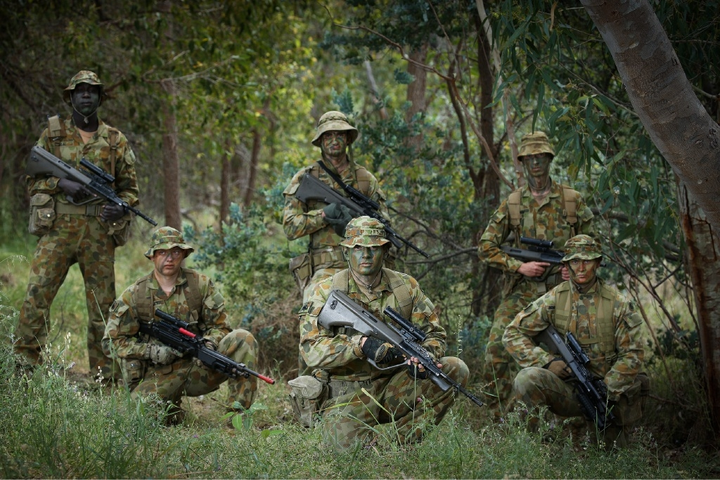 Left: Private Isaac Cagai, Lance Corporal Zac Muscat, Sapper Christopher James Beeson, (front) Private Wade Beasley, Private Anthony Jerkovic and Private Dylan Bennett-Surtees. Top right: Wade Beasley trains his sights on a target. Below right: Training ahead of deployment to Malaysia.Pictures: Andrew Ritchie www.communitypix.com.au   d445086