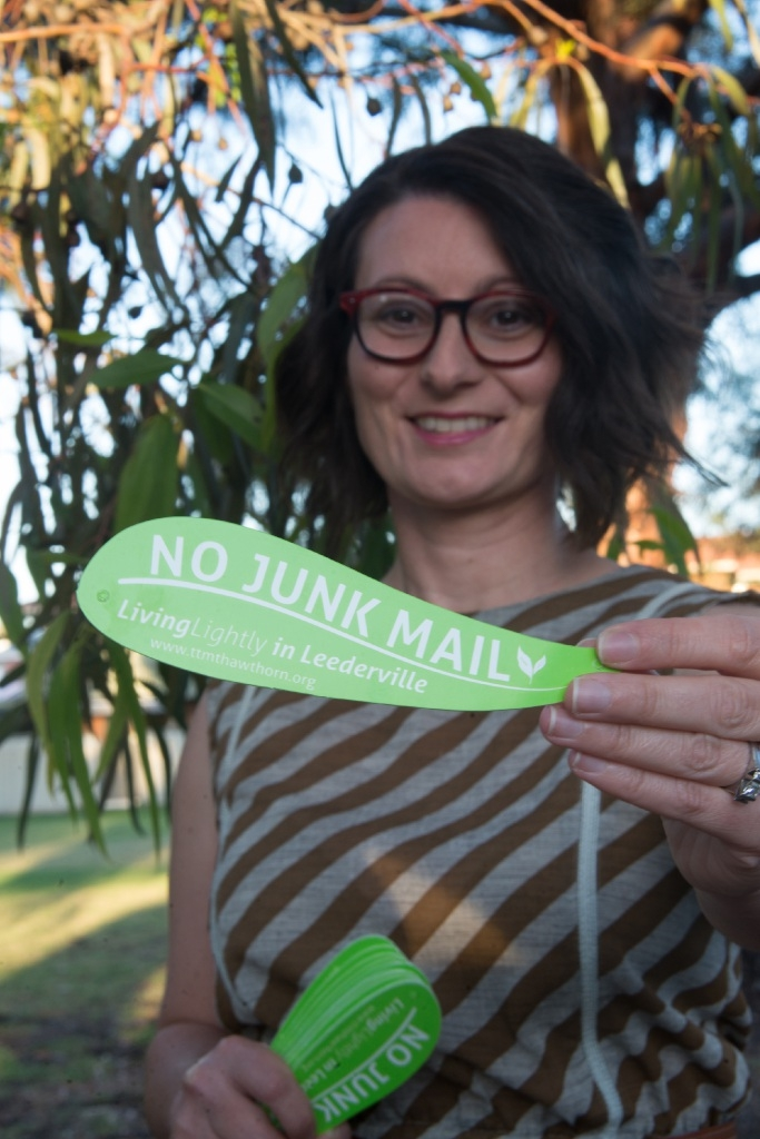Gabby Pracilio with a handful of the 'no junk mail' leaf signs. About 50 of the signs have disappeared in mysterious circumstances in Mt Hawthorn.