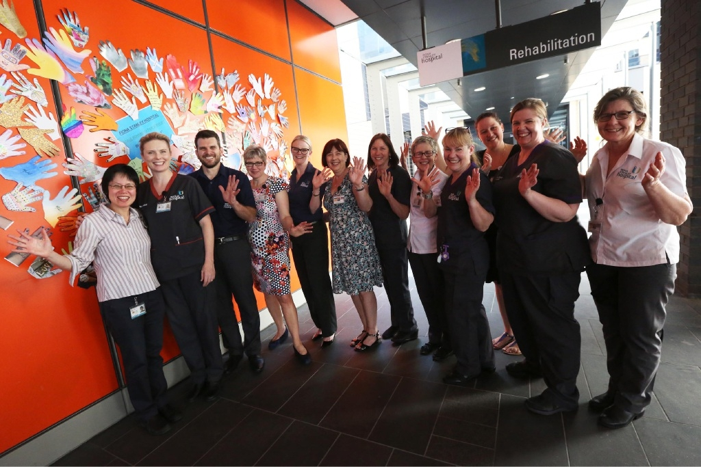 Staff at the State Rehabilitation Service created a 'Hands Up' collage to celebrate their first anniversary.  Picture: Matt Jelonek        www.communitypix.com.au   d444849