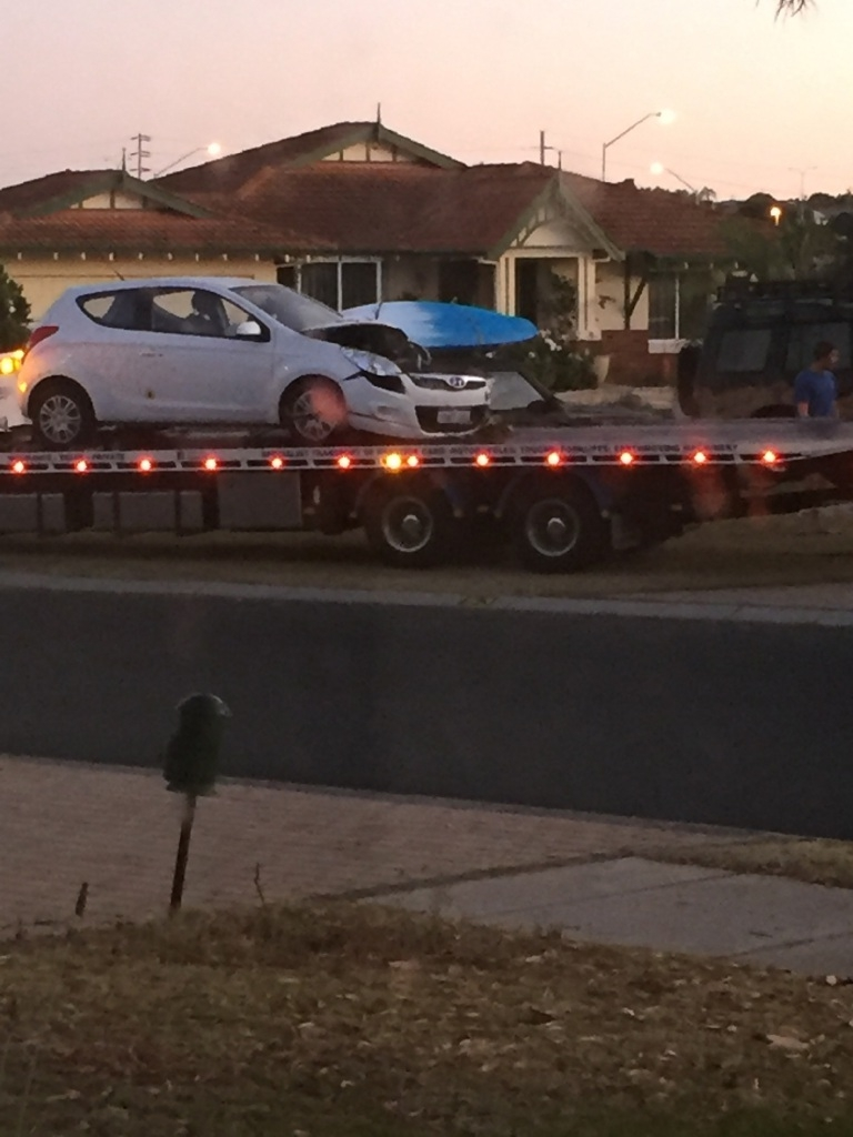 The Hyundai involved in the crash was loaded onto a tow truck.