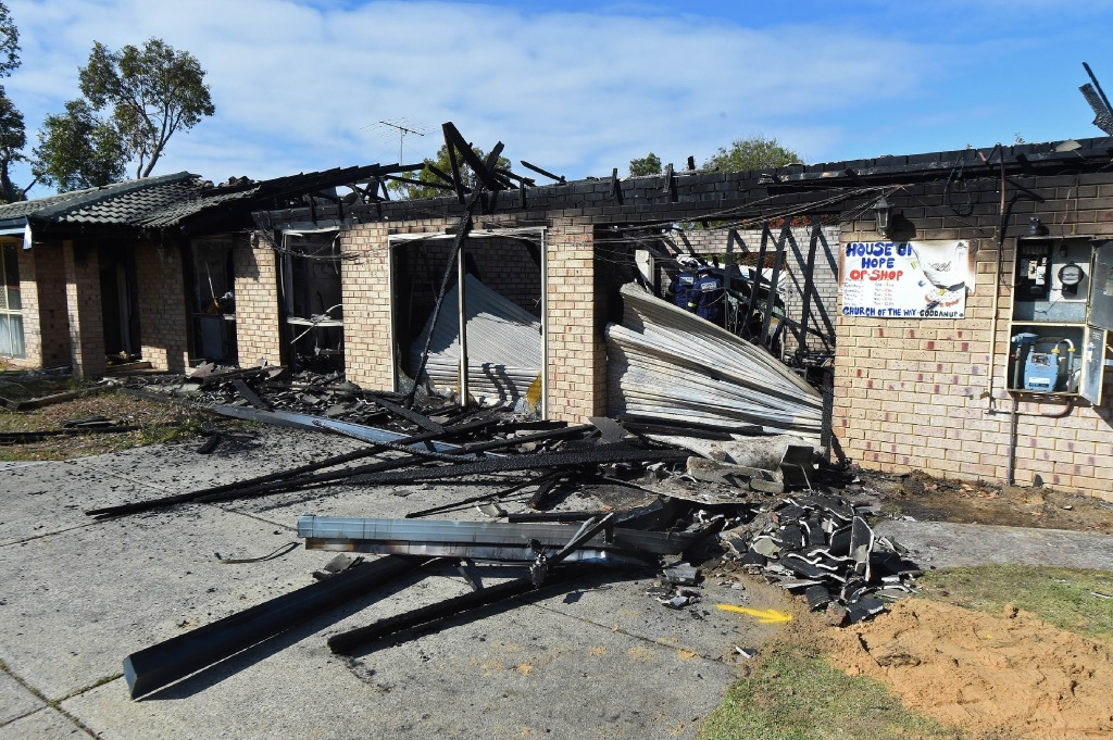 No hope: Firefighters could not save the House of Hope op-shop from a blaze on Sunday night.