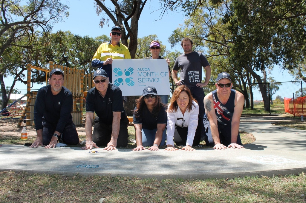 Orelia Primary School principal Joanne Stewart-Magee (front, second from right) with Alcoa staff at the new bike path.
