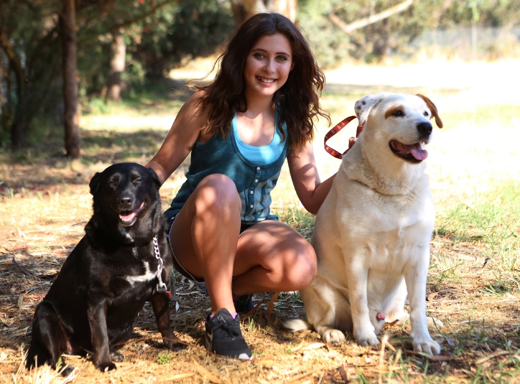 Jordyn Scott, of Stratton, with dogs Huni and Patch.         d445126
