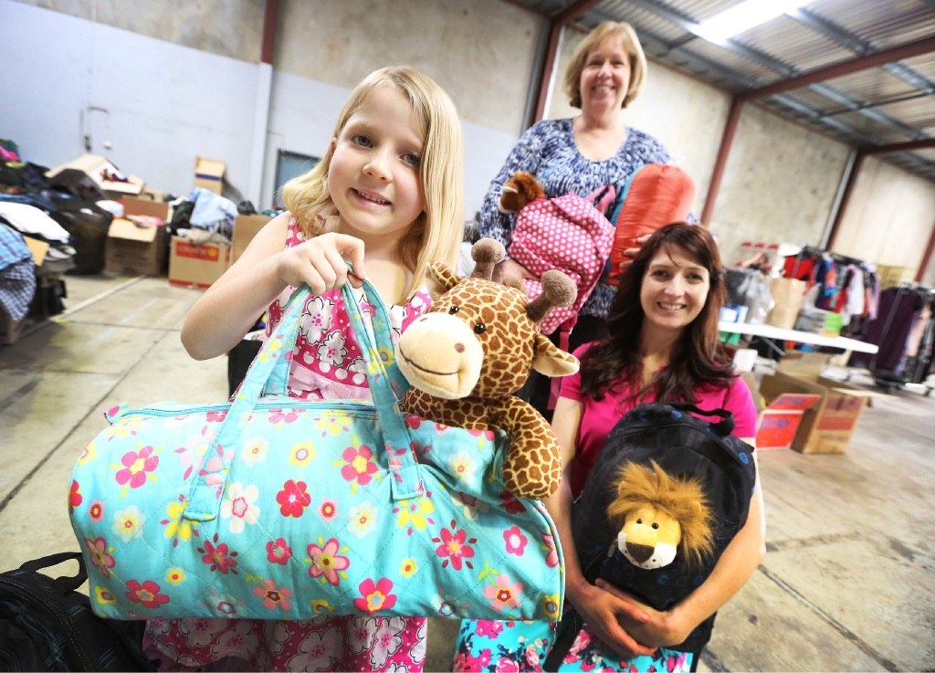 Ayla with mother Donna (right) and Jill, from Homeless Connect. Picture: Matt Jelonek        www.communitypix.com.au   d445142