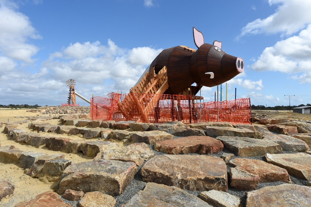 The planned park will feature a giant pig structure.