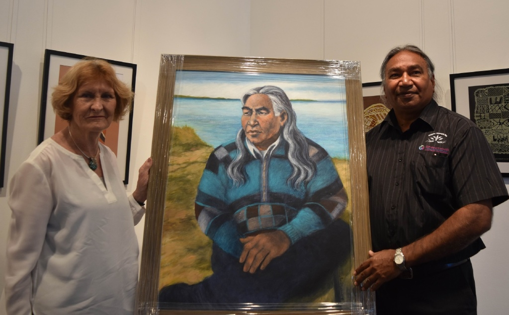 Artist Joanna Capelle and George Walley with the portrait of Walley.