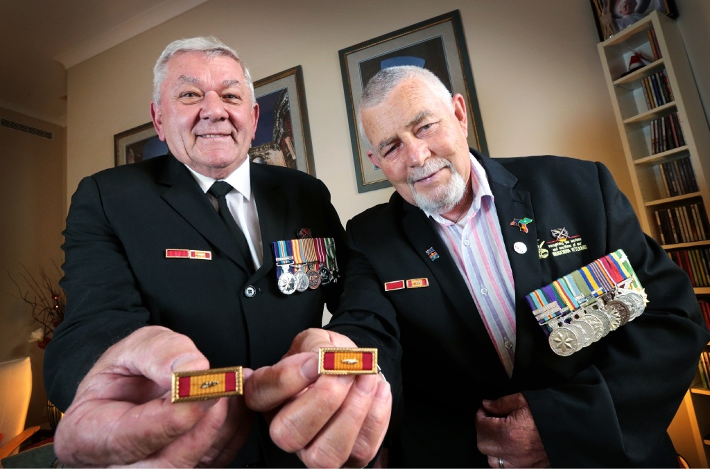 Frank Mallard and Hans Hurij with the medals awarded to them decades after the war. Picture: David Baylis        d444997